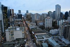 Robson street in Vancouver and the busy skyline. Royalty Free Stock Photography