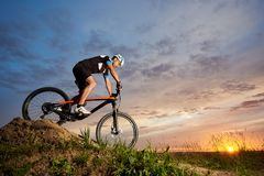 Robust cyclist riding bike and rolling down hill. stock image