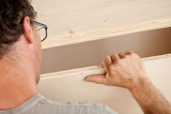 Robust hand of a carpenter placing a piece Stock Photo