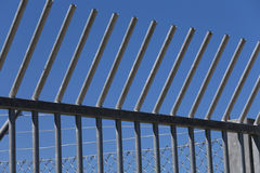 Robust steel barriers in the camp for migrant migrants. Robust steel barriers to delineate the camp for migrant migrants Stock Images