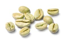 Robusta green coffee beans. On white background royalty free stock photography