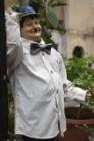 Robuste Statue als Kellner stockfotografie