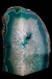 Roca cristalina en fondo negro Imágenes de archivo libres de regalías