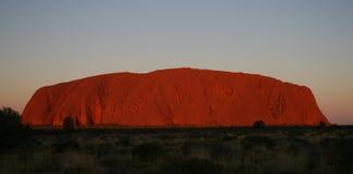 Roca de Uluru Ayers en la puesta del sol Imagen de archivo libre de regalías