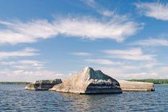 Roca en el agua Foto de archivo libre de regalías