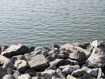 Roca en el lago Imágenes de archivo libres de regalías