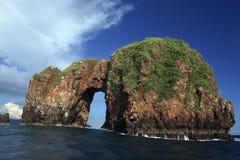 Roca en el océano Imagen de archivo