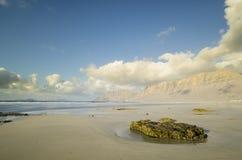 Roca en la playa de Famara Foto de archivo libre de regalías