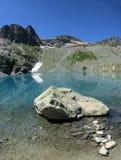 Roca grande en el lago Foto de archivo libre de regalías