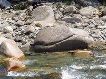 Roca grande en el río Irkut Fotos de archivo libres de regalías