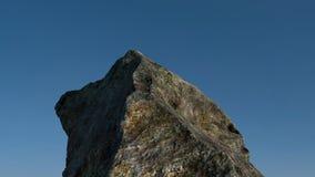 Roca /mountain delante del cielo azul 3d rinden Foto de archivo