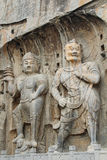 Roca que talla en las grutas de Longmen, Luoyang, China de la estatua de Buda imágenes de archivo libres de regalías