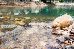 Roca redonda en el río Fotografía de archivo libre de regalías