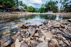 Roca redonda en el río Imagen de archivo libre de regalías