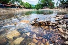 Roca redonda en el río Imagen de archivo