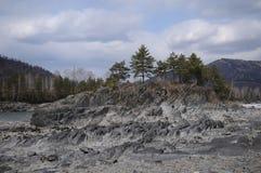 Roca y árboles Imagen de archivo