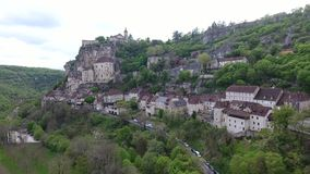 Rocamadour valley views: village on hillside, castle on top stock footage
