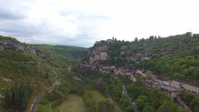 Rocamadour valley views: village on hillside, castle on top. Top interestings point in France. Its historical monuments and its sanctuary of the Blessed Virgin stock video footage