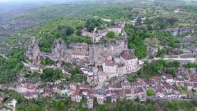 Rocamadour valley views: village on hillside, castle on top stock video