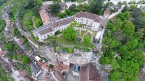Rocamadour valley views: village on hillside, castle on top stock video footage