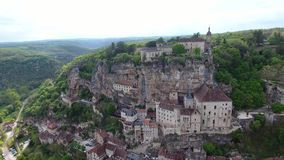 Rocamadour valley views: village on hillside, castle on top. Top interestings point in France. Its historical monuments and its sanctuary of the Blessed Virgin stock footage