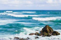 Rocas en las ondas Foto de archivo