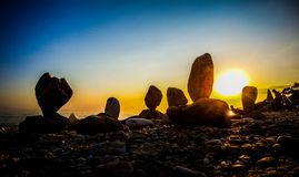 Rocas en puesta del sol Fotografía de archivo libre de regalías