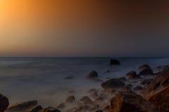 Rocas en un mar tranquilo Fotografía de archivo libre de regalías