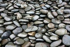 Rocas lisas, redondas del océano Fotografía de archivo libre de regalías
