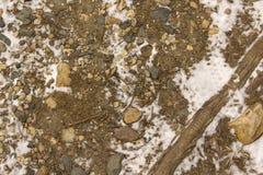 Rocas, suciedad y nieve Imagen de archivo libre de regalías