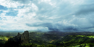 Rocca Malatina, Italy: Magic landscape. On green mountain and suggestive sky Stock Photography