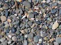 Rocce arrotondate della spiaggia Fotografie Stock
