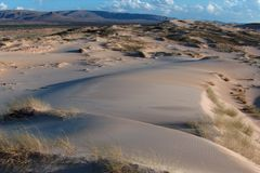 Rocce del paesaggio di tramonto del deserto Fotografie Stock Libere da Diritti