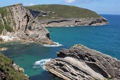 Rocce della spiaggia dell'oceano Immagine Stock