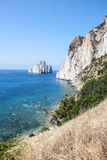 Rocce di Pan di Zucchero nella pila del mare di Masua e del mare (Nedida), Immagini Stock Libere da Diritti