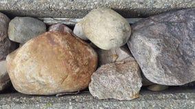 Rocce e calcestruzzo Fotografia Stock