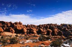 Rocce e neve rosse Fotografia Stock