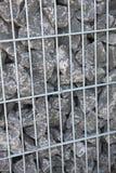 Rocce grige in una gabbia Fotografia Stock