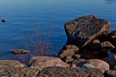 Rocce in porto Immagini Stock