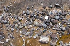 Rocce sul bordo del geyser Immagine Stock
