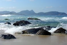 Rocce sulla spiaggia Immagini Stock