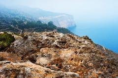 Roccia del calcare e scogliera di Dingli del ayer del sedimento, Malta Fotografie Stock