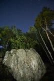 Roccia e cielo notturno Immagine Stock