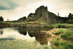Roccia e stagno del basalto Fotografia Stock