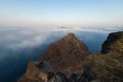 Rocha de Skaros cercada por nuvens | Santorini Fotografia de Stock