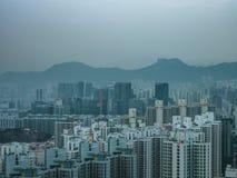 Rocha do leão e construção, Hong Kong Fotografia de Stock