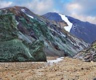 A rocha e o córrego de pedra verdes Imagens de Stock Royalty Free