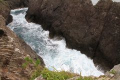 A rocha e Ranboya de Kaminariiwa gorge na costa de Goishi imagem de stock royalty free