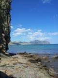 rocha em um mar Fotos de Stock