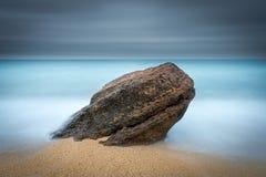 Rocha na areia Foto de Stock